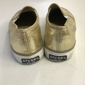 Metallic distressed gold slip on Sperry shoes